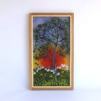 Picture of a tree at sunset framed in oak.
